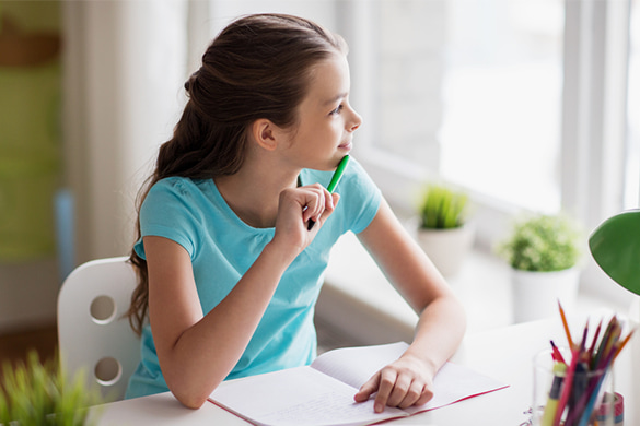 a girl pauses and thinks during her homework